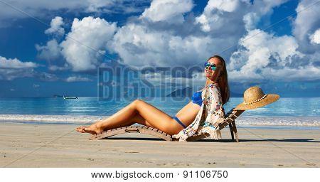 Woman in bikini on tropical beach at Seychelles