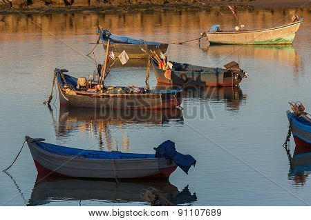 Old wooden fishing boats.