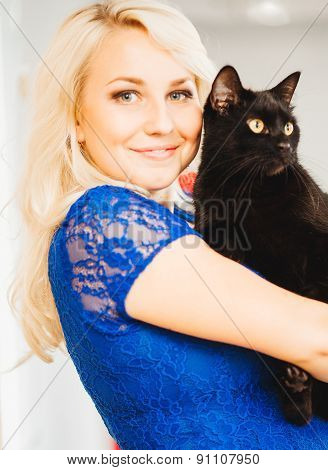Blonde Girl With Beautiful Smile And Eyes In Blue Dress Black Cat