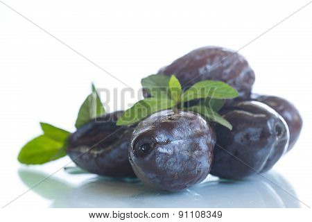 Dried Plums With A Sprig Of Mint