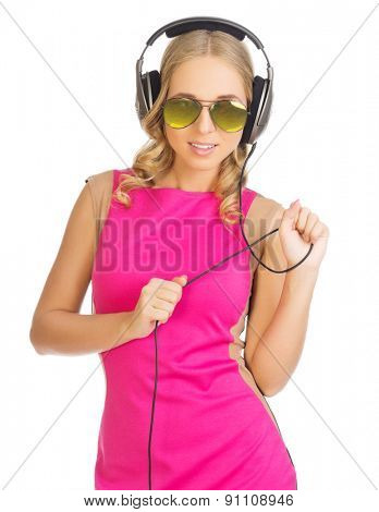 Girl with sunglasses and headphones isolated