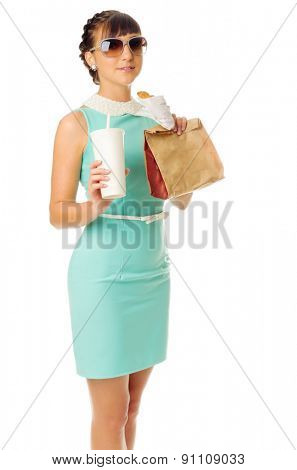 Glamorous girl in turquoise dress holds snacks isolated