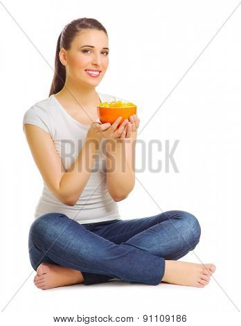 Young woman with fruit salad isolated