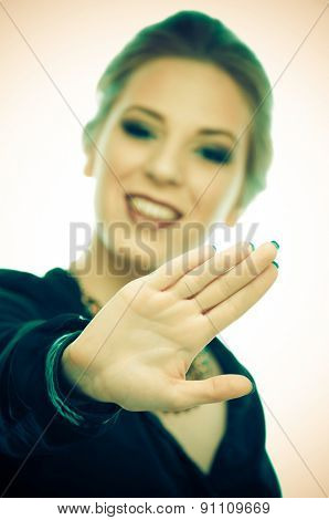 Woman with outstretched palm (for your text) in front of her