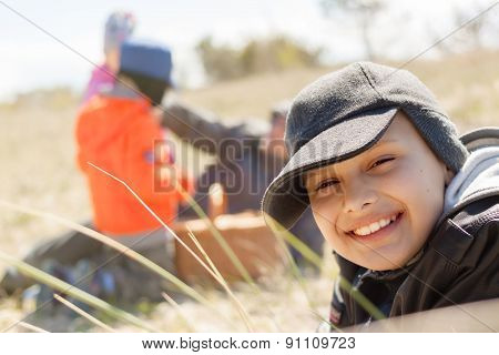 children on picnic, happy smile, outdoor, close up, lying on the grass, shallow DOF