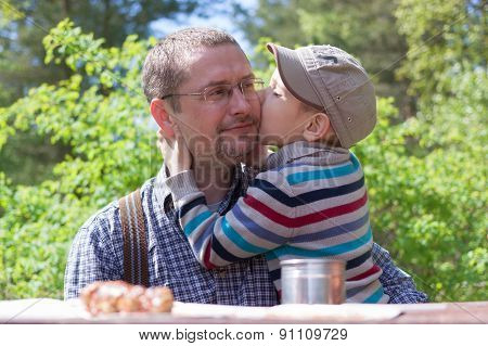 parent and child happy hugging, outdoor lifestyle