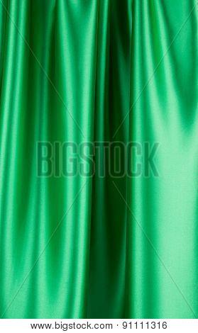 Green silk cloth with soft folds.