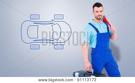 Repairman with toolbox and monkey wrench against grey vignette