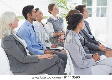 Business people listening during meting in office