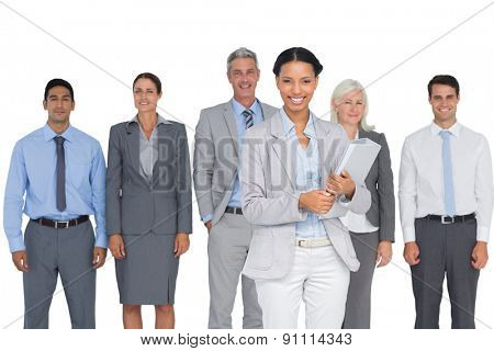 Business people smiling at camera on white background