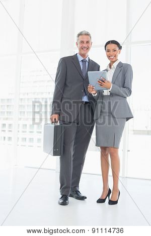 Business people using tablet computer in office