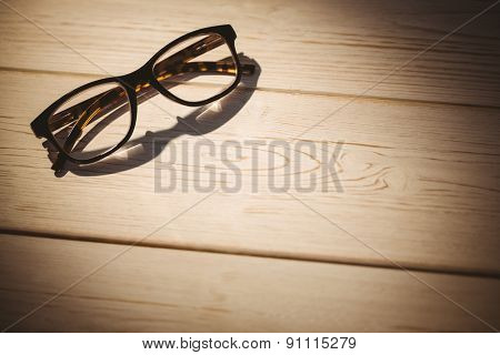 Reading glasses on a desk