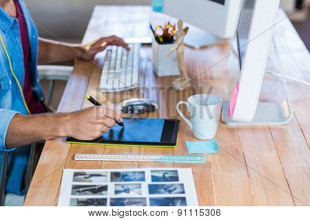 Businessman working with digitizer at his desk in the office