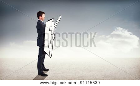 Corporate warrior against cloudy sky background