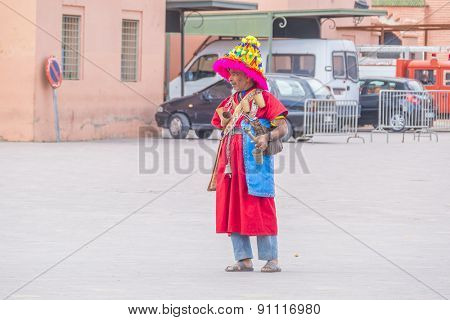MARRAKESH, MOROCCO, APRIL 3, 2015: Jemaa el-Fnaa square - seller of water in traditional attire