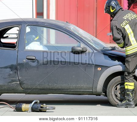 Firefighter During Training Exercise Cuts The Windscreen Of The Car
