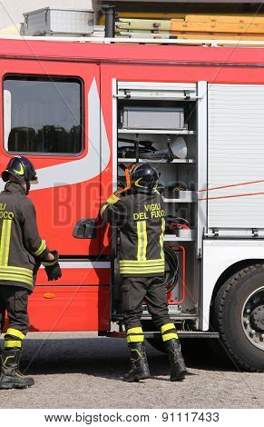 Italian Firefighters During An Emergency With  Helmets