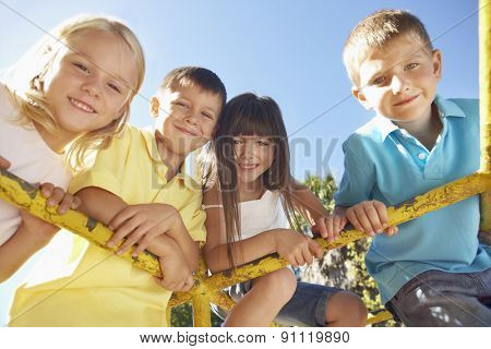Group Of Children Playing On Climbing Frame