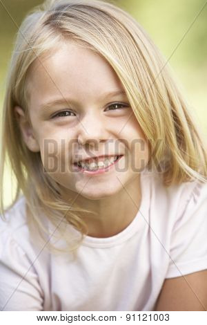 Portrait Of Young Girl Outside In Park
