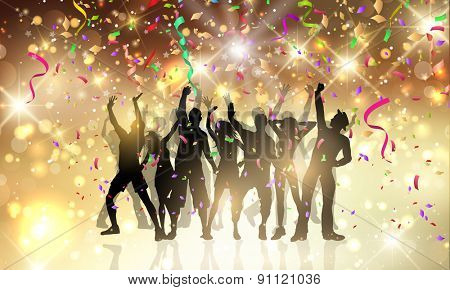 Silhouettes of people dancing on a background with confetti and streamers