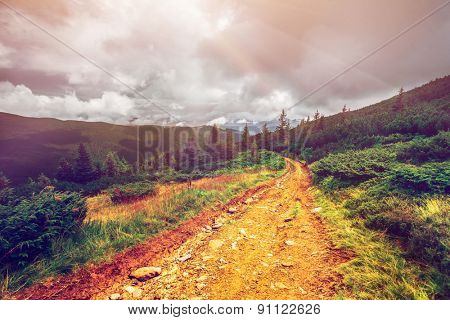 Trail leading through the mountain valley. Beauty world.