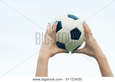 Woman Hold A Soccer Ball Up Into The Sky