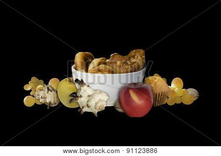 Baking apples and shells mollusks on black background