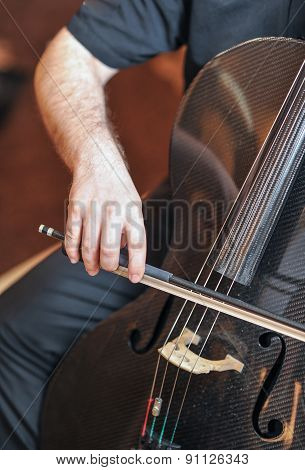 Man playing the cello, hand close up. Cello orchestra musical instrument playing cellist musician