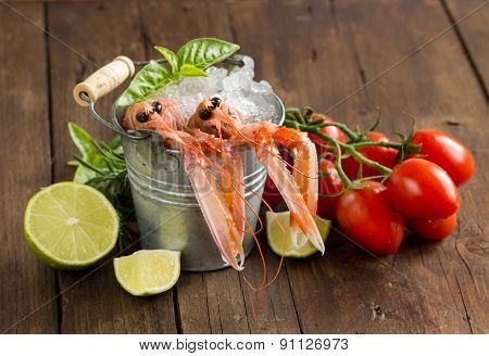 Raw Langoustine In A Bucket With Vegetables And Herbs