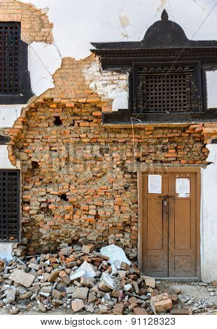 KATHMANDU, NEPAL - MAY 14, 2015: Detail of a damaged facade on Durbar Square which was partially destroyed after two major earthquakes hit Nepal in the past weeks.