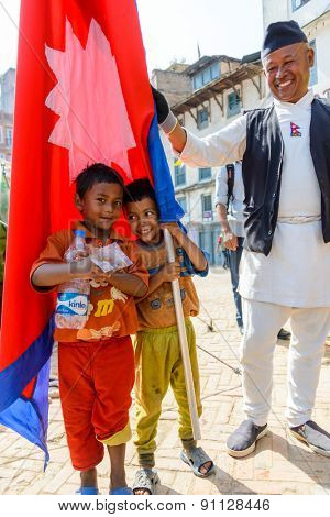 KATHMANDU, NEPAL - MAY 14, 2015: Two children poses with a Nepal flag.