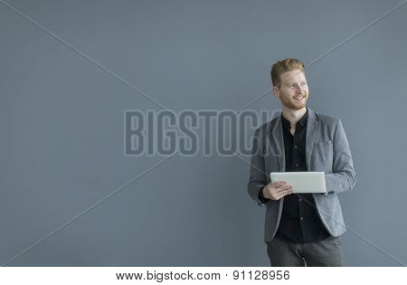 Man With Tablet By The Wall