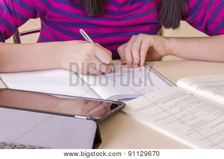 Schoolgirl Doing Her Homework Using Digital Tablet