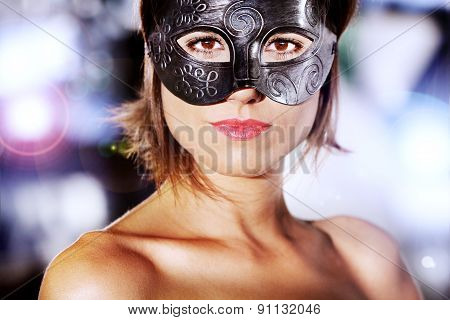 Portrait of beautiful and mysterious woman with carnival mask