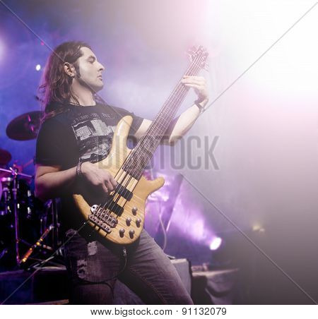 Man playing electric bass live. Concept live music.