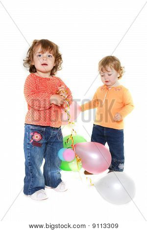 Two Cute Toddler Girls With Balloons