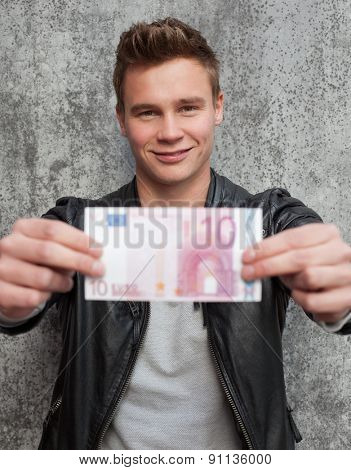 Casual young guy holding ten euro note