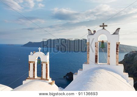 white belfries Santorini island, Greece