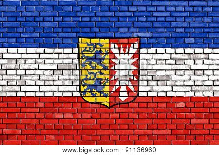 Flag Of Schleswig Holstein Painted On Brick Wall