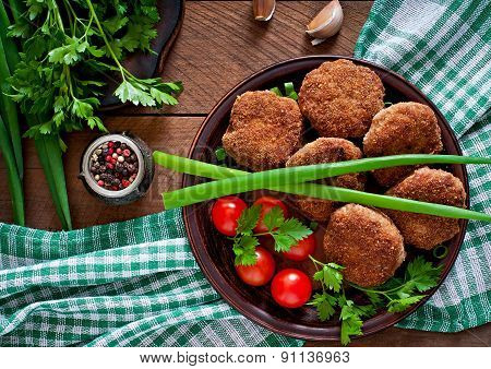 Juicy delicious meat cutlets on a wooden table in a rustic style.Selective focus