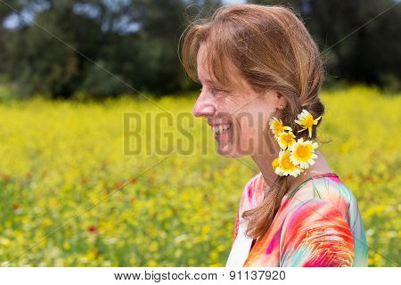 Woman with braid and yellow flowers