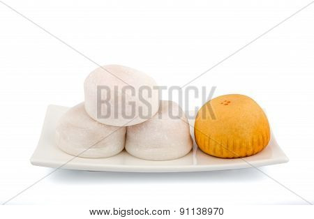 White And Orange Mochi On The White Plate