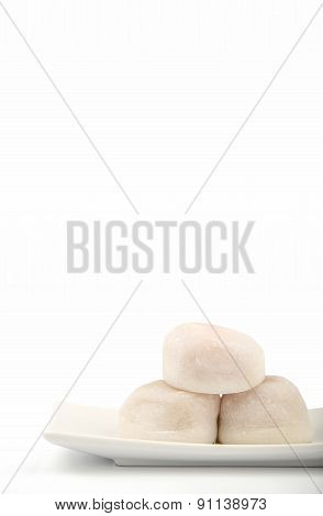 Three White Mochi On White Background In Vertical