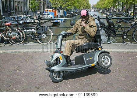 Disabled Man Stunts On Scoot Mobile On Bridge In Centre On Amsterdam