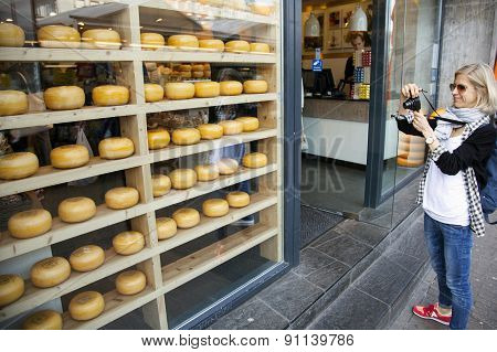 Tourist Takes Picture Of Dutch Cheeses In Amsterdam