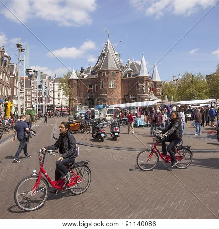 Tourists Ride Rental Bikes On Nieuwmarkt In Amsterdam