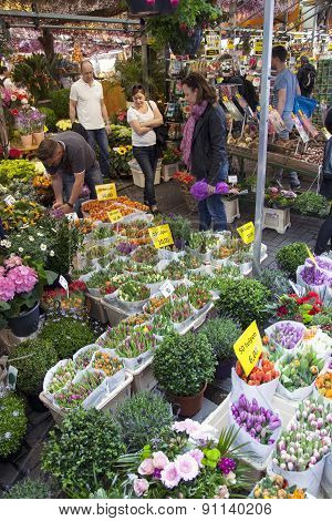 Tourists Look At Merchandise On Amsterdam Flower Market