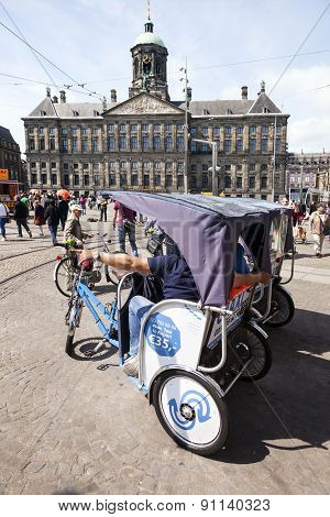 Bicycle Taxi On Dam Square In Front Of Amsterdam Royal Palace
