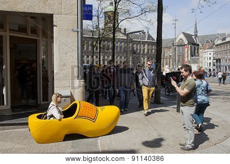 Man Takes Picture Of Woman In Giant Yellow Clog In Amsterdam