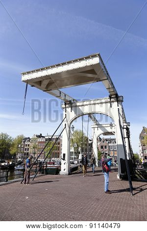 People Take Pictures On Skinny Bridge In Amsterdam
